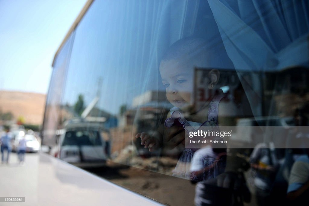 A Syrian baby watch outside from a car, on the way to flee from Syria ahead of possible U.S. militay action at an immigration passport control at the border city of Al-Masnaa on August 31, 2013 in al-Masnaa, Lebanon. U.S. President Barack Obama states that he will seek Congressional authorization for the U.S. to take military action following the events in Syria.