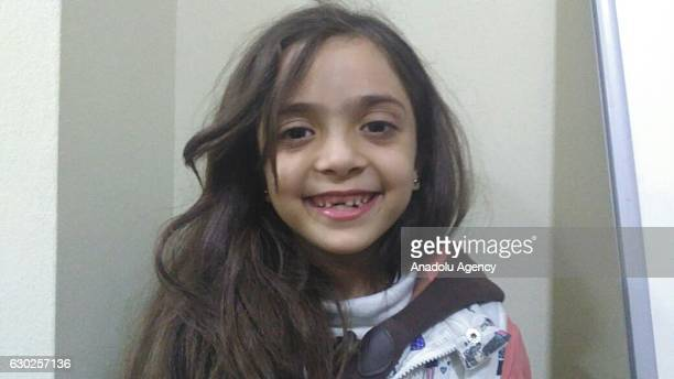 Syrian Bana Alabed sevenyearold girl who tweeted on attacks from Aleppo is seen after being evacuated from the city in Idlib Syria on December 19 2016