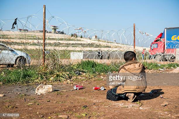 syrian boy at turkish border - refugee camp stock pictures, royalty-free photos & images
