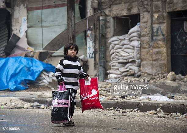 Syrian boy is seen among other civilains leaving a rebelheld area of Aleppo towards the governmentheld side on December 13 2016 during an operation...