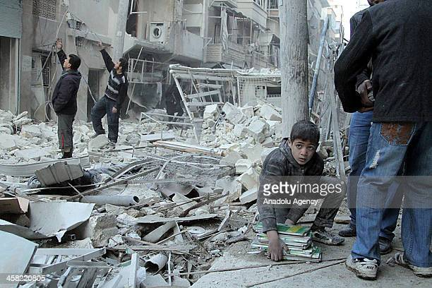 Syrian boy is seen following an airstrike of Syrian Air Forces in alSukari neighborhoods of Aleppo Syria on December 20 2013 The strikes in several...