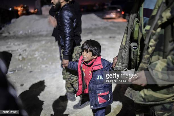 Syrian boy lost his parents as Syrians fleeing the northern embattled city of Aleppo wait on February 5 2016 in BabAl Salama next to the city of Azaz...