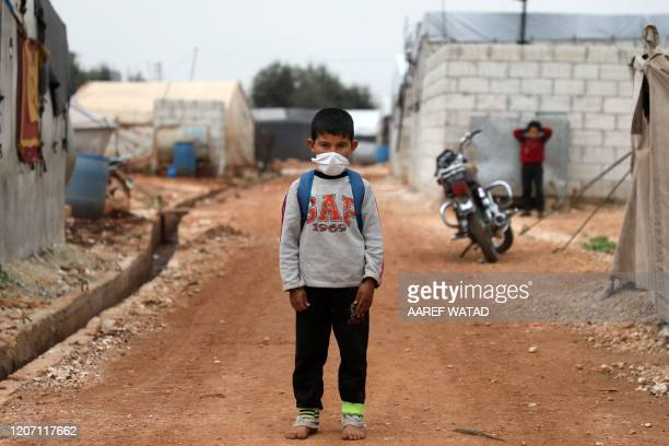 Syrian boy poses for a picture during an awareness workshop on Coronavirus held by Doctor Ali Ghazal at a camp for displaced people in Atme town in...