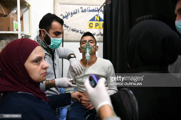 Syrian boy receive treatment at a hospital in the regime controlled Aleppo on November 24 2018 Official Syrian media accused the armed opposition of...