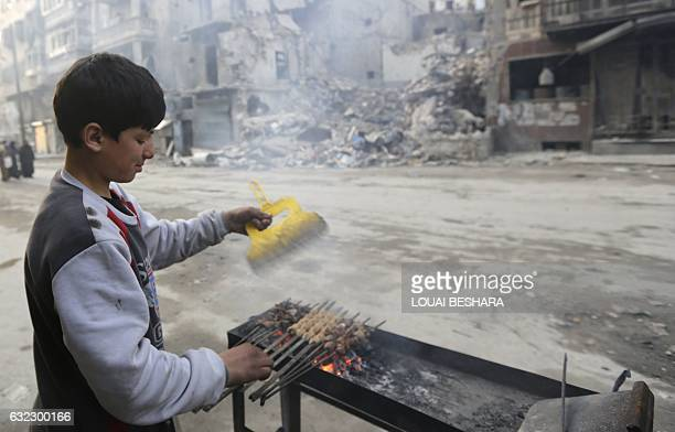A Syrian boy sells barbequed meat in Aleppo's formerly rebelheld alShaar neighbourhood on January 21 a month after government forces retook the...