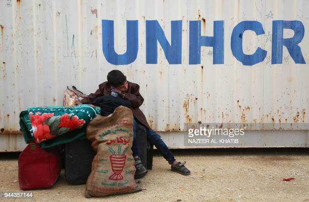 Syrian boy sits at a camp for displaced Syrians after buses carrying Jaish al-Islam fighters and their families from their former rebel bastion of...