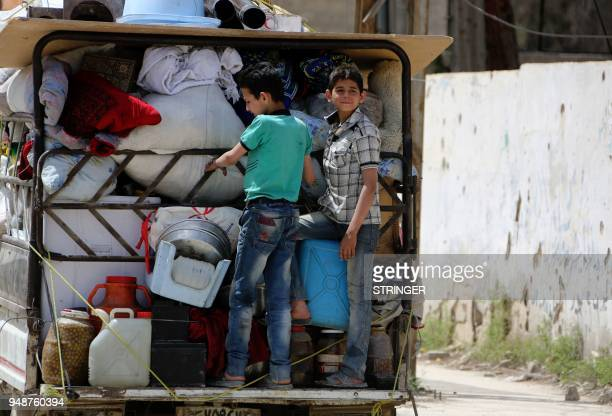 Syrian boy stand on the back of a vehicle in the former rebelheld Syrian town of Douma on the outskirts of Damascus on April 19 five days after the...
