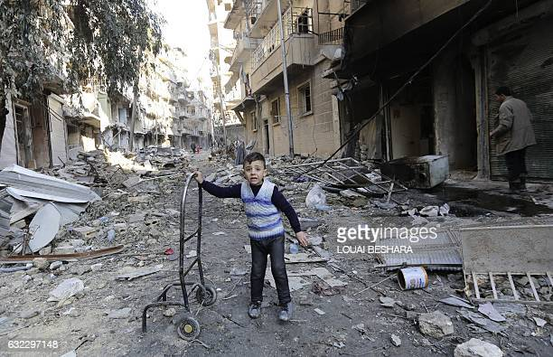 Syrian boy stands amid the rubble in Aleppo's formerly rebelheld alShaar neighbourhood on January 21 a month after government forces retook the...
