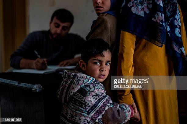 Syrian boy waits to receive treatment for leishmaniasis skin disease at a health centre in Karama, in northern Syria, about 26 kilometres east of...