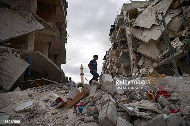 A Syrian boy walks on the rubble of destroyed buildings in the northern Syrian city of Aleppo on April 10 2013 The United States is mulling ways to...