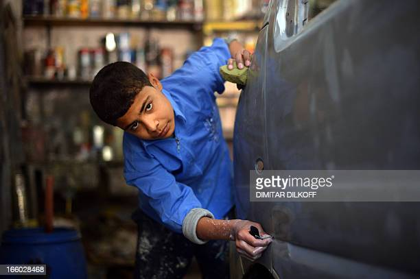 Syrian boy works at a garage in the northern Syrian city of Aleppo on April 6 2013 Conflict in neighbourhoods of Aleppo which has been shaken by war...