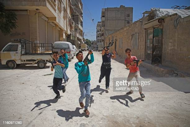 TOPSHOT Syrian boys play with plastic guns on the first day of the Muslim religious festival of Eid alAdha in alDana in Syria's rebelcontrolled Idlib...