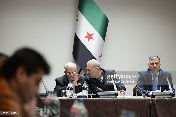 Syrian Chairman of the National Coordination Committee for the Forces of Democratic Change Hassan Abdel Azim talks with member of the Syrian National...