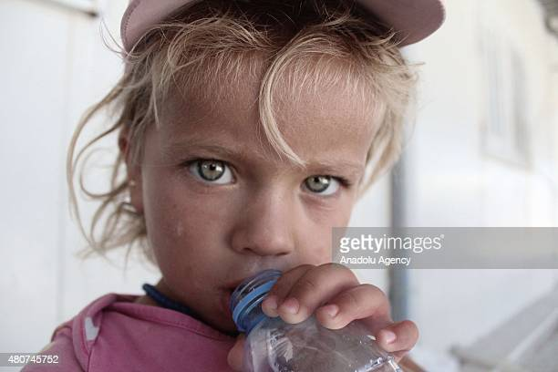 Syrian child at a refugee camp in Suruc district of Sanliurfa on July 14 as the Syrian Kurds who fled the clashes between Daesh and Kurdish armed...