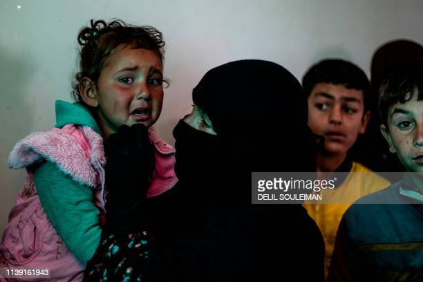 A Syrian child cries as she waits to receive treatment for leishmaniasis skin disease at a health centre in alKaramah in northern Syria about 26...
