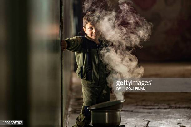 Syrian child displaced from Ras al-Ain, a border town controlled by Turkey and its Syrian proxies, is pictured in a school turned into a shelter in...