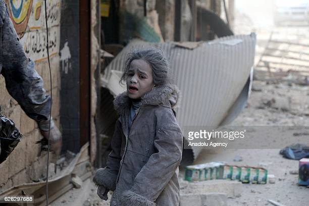 Syrian child girl is seen at the scene of the air strikes carried out by the war crafts belonging to Russia and Assad regime forces in alShear...