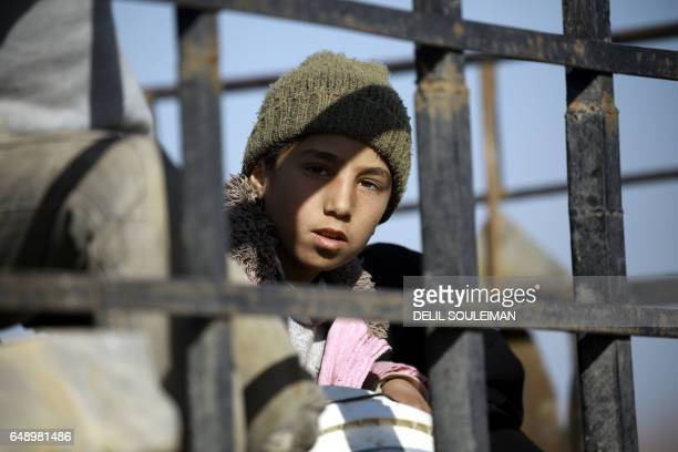 Syrian child is seen at a makeshift camp for displaced people near the town of Manbij on March 6 2017 Tens of thousands of civilians have fled parts...