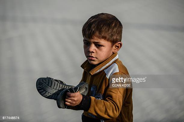 A Syrian child plays at a refugee camp in the Kilis district of Gaziantep southeastern Turkey on October 23 2016 France's foreign minister urged the...