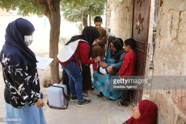 Syrian child receives polio vaccine during a vaccination campaign for 45000 Syrian children organised by Sanliurfa Governorate's Syria Support and...