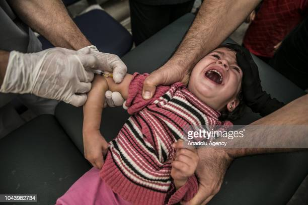 Syrian child receives vaccination during polio measles mumps vaccination campaign for Syrian children at Bab alHawa Border Crossing and Cilvegozu...