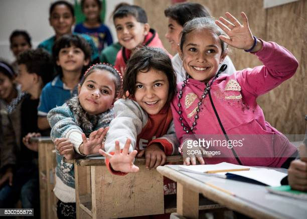 Syrian Child refugees are laughing and learning in class at a school recently built in a refugee camp at Al Marj