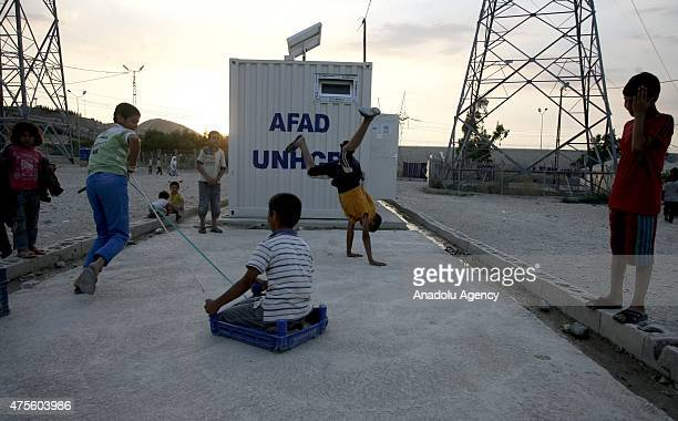 Syrian child refugees playing near a container at a refugee camp site which is constructed by Turkish Prime Ministry's Disaster and Emergency...