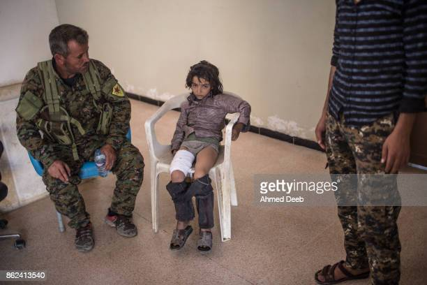 Syrian child sits in a military field hospital after he was injured by a mine which exploded when a group of civilians were escaping the Islamic...