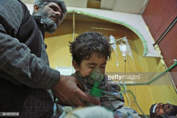 Syrian children and adults receive treatment for a suspected chemical attack at a makeshift clinic on the rebelheld village of alShifuniyah in the...