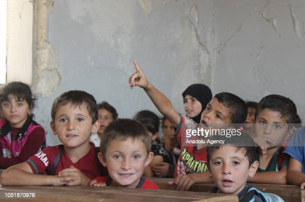 Syrian children are seen at a classroom at the Jisr alShughur district of Idlib Syria on October 6 2018 Some parts of the school were destroyed by...