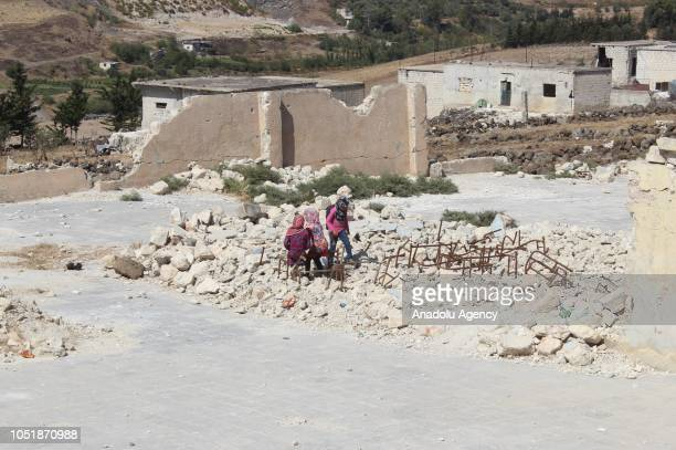 Syrian children are seen at the school yard during their break at the Jisr alShughur district of Idlib Syria on October 6 2018 Some parts of the...