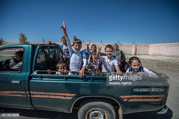Syrian children are seen in a vehicle at the customs gate in the Karkamis district of Gaziantep Turkey on September 30 2016 They return to Jarabulus...