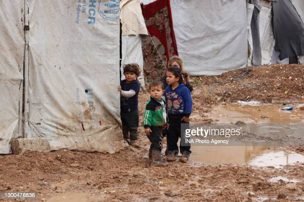 Syrian children at camps on the Syrian-Turkish borders in Syria on January 29, 2021. Dozens of tents in a camp were damaged as a result of the heavy...