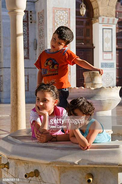 syrian children at the umayyad mosque - damascus stock pictures, royalty-free photos & images