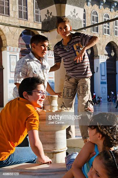syrian children at umayyad mosque in damascus - damascus stock pictures, royalty-free photos & images