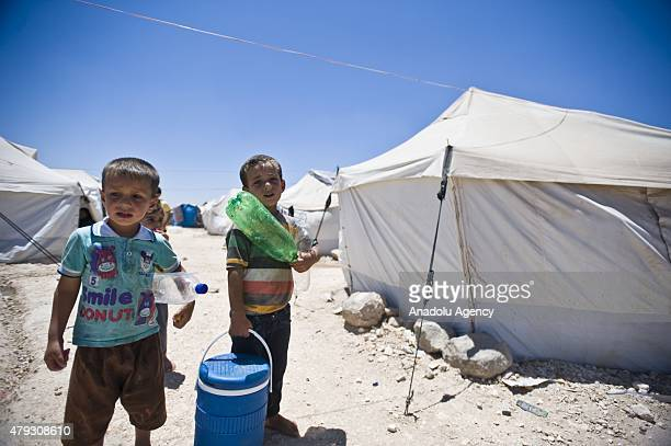 Syrian children fled their home due to the clashes in regions hold on life in container cities built by relief organizations in the Azez district of...