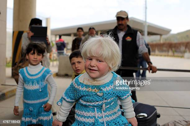 Syrian children gather in at the Cilvegozu border crossing during a polio vaccination campaign coordinated by the World Health Organization in Hatay,...