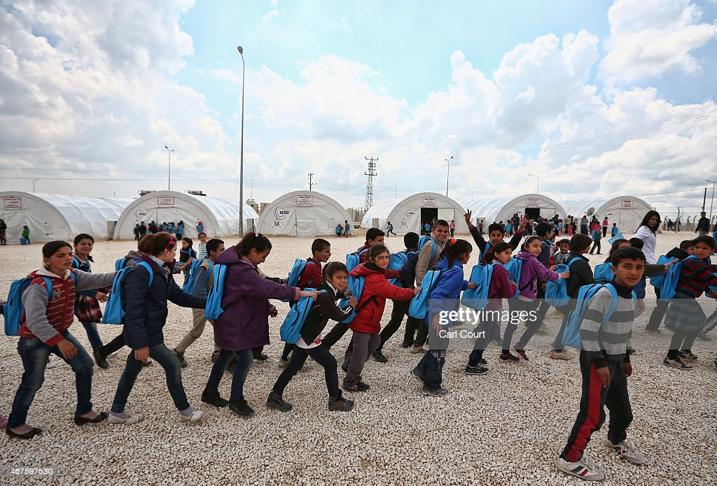 Syrian Refugees Seek Shelter In Turkish Camps : News Photo