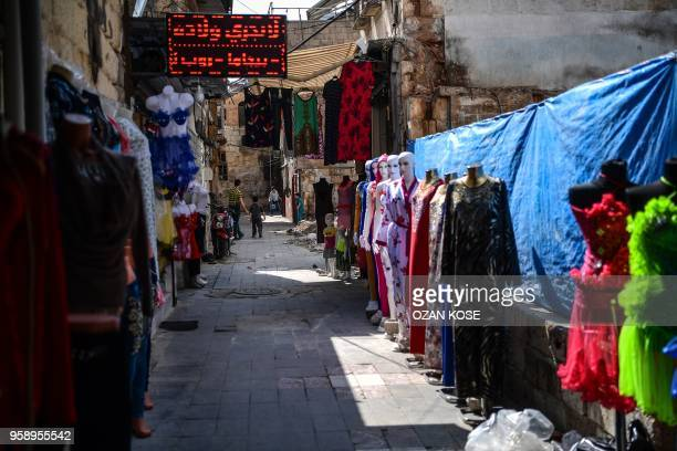 Syrian children play in a shopping street in Gaziantep in the southwest province of Turkey on May 1 2018 In the Turkish city of Gaziantep home to...