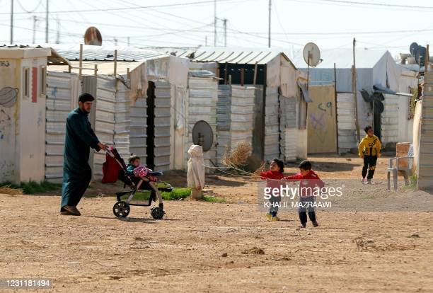 Syrian children play in the Zaatari refugee camp, 80 kilometers north of the Jordanian capital Amman on February 15, 2021.