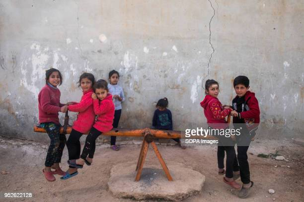 Syrian children playing in a park in Ahras in the northern Syrian enclave of Afrin Tens of thousands of people were displaced by the Turkishled...