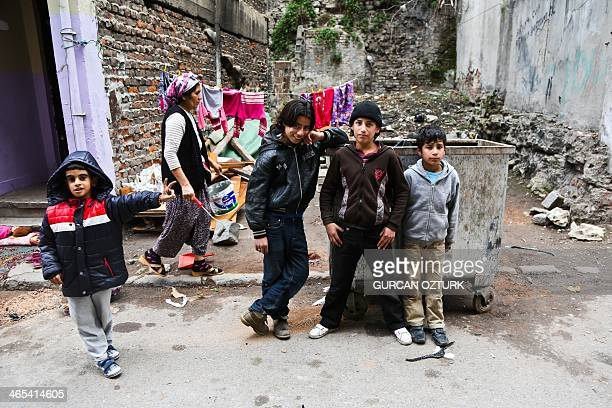 Syrian children pose on January 27 2014 in the Kucukpazar district of Istanbul Syrians fill houses which have been evacuated for urban development...