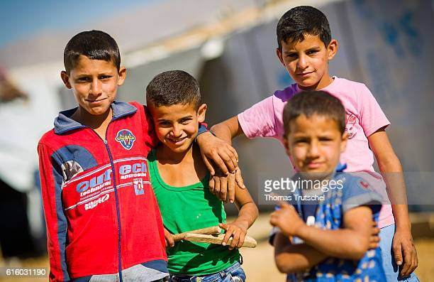 Syrian children posing for a photo in a refugee camp in the Bekaa plain on October 06 2016 in Bar Elias Lebanon