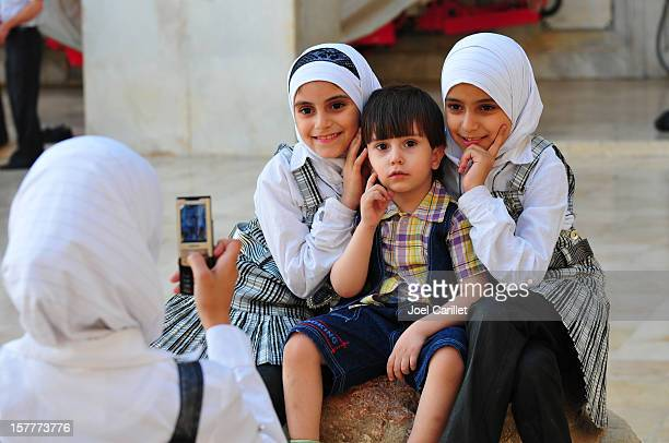 Syrian children posing for photograph at Umayyad Mosque in Damascus