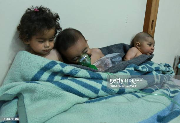TOPSHOT Syrian children receive treatment for a suspected chemical attack at a makeshift clinic on the rebelheld village of alShifuniyah in the...