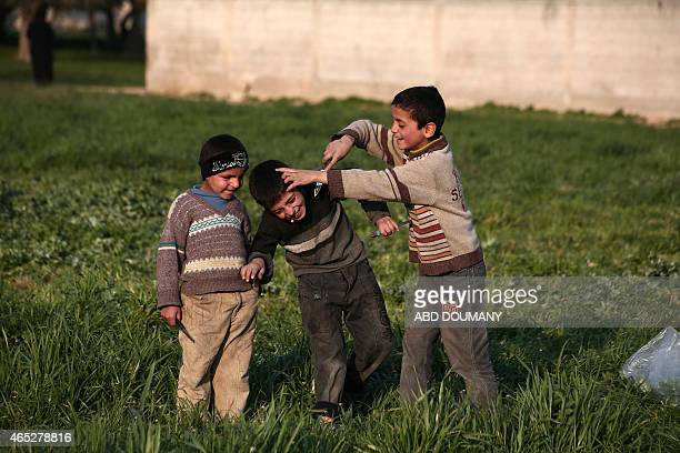 Syrian children reenact scenes they said to have seen in Islamic State jihadist group videos in the rebelheld Damascus suburb of Douma on March 5...