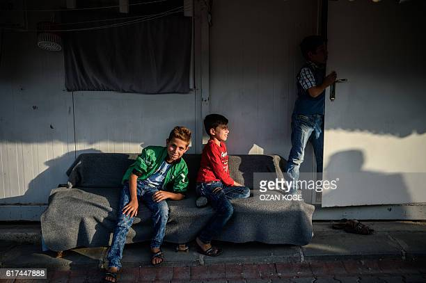 Syrian children sit at a refugee camp in the Kilis district of Gaziantep southeastern Turkey on October 23 2016 France's foreign minister urged the...