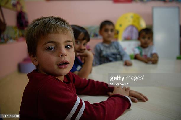 Syrian children sit in a classroom at the school of the Kilis refugee camp in Gaziantep southeastern Turkey on October 23 2016 France's foreign...