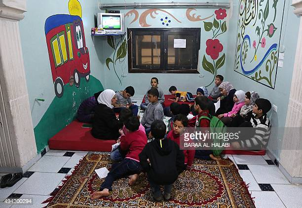 Syrian children study at the Mumayazoun children's orphanage in the Salah alDin neighbourhood in the northern city of Aleppo on October 25 2015 The...