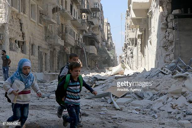 Syrian children try to escape from the site after warcrafts belonging to the Russian army bombed the opposition controlled Firdevs neighborhood in...